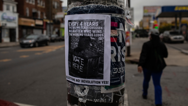 "A line on a flyer posted on a lamppost in Philadelphia's west reads ""Elections no! Revolution yes!"" on Wednesday, Oct. 28, 2020. Protests have erupted in the neighborhood following the police shooting death of Walter Wallace, Jr. (AP Photo/Robert Bumsted)"