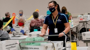 Election workers sort ballots Wednesday, Oct. 21, 2020 at the Maricopa County Recorder's Office in Phoenix. (AP Photo/Matt York)