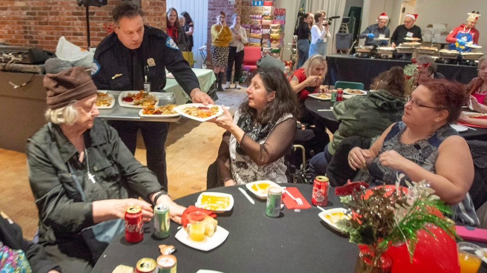 Montreal police Const. Giuseppe Boccardi serves Christmas dinner at the Chez Doris women's shelter Wednesday, December 12, 2018 in Montreal.THE CANADIAN PRESS/Ryan Remiorz