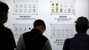 Semiconductors on display from the Tsinghua Unigroup at the China Beijing International High Tech Expo in Beijing, on Sept. 19, 2020. (Mark Schiefelbein / AP)