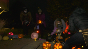 Jacqueline Gold's friends carved 50 pumpkins on her lawn to celebrate her 50th birthday. (Shaun Vardon/CTV News Ottawa)