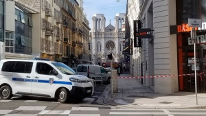 In this photo provided by Tom Vannier, police are at the scene of an attack in Nice, France, Thursday, Oct. 29, 2020. An attacker armed with a knife killed three people at a church in the Mediterranean city of Nice, the third attack in two months in France. The assailant was shot by police and hospitalized after the killings at the Notre Dame Church on Thursday. (Tom Vannier via AP)