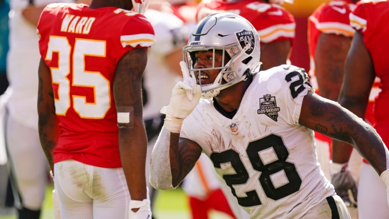 Las Vegas Raiders running back Josh Jacobs celebrates after scoring on a 7-yard touchdown run during the second half of an NFL football game against the Kansas City Chiefs, on Oct. 11, 2020. (Charlie Riedel / AP)