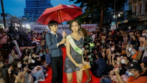 "Protesters perform on a mock fashion ""red carpet"" while taking part in a protest in Bangkok, Thailand, Thursday, Oct. 29, 2020.  (AP Photo/Gemunu Amarasinghe)"