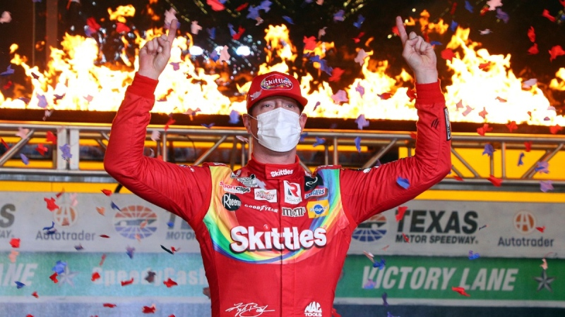 Kyle Busch celebrates in Victory Lane after winning the NASCAR Cup Series auto race at Texas Motor Speedway in Fort Worth, Texas, on Oct. 28, 2020. (Richard W. Rodriguez / AP)