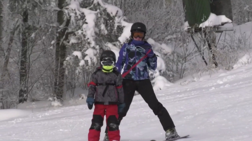 Parent and child on Timmins ski hill