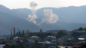Smoke rises after shelling by Azerbaijan's artillery during a military conflict outside Stepanakert in Nagorno-Karabakh, Thursday, Oct. 29, 2020. (AP Photo)