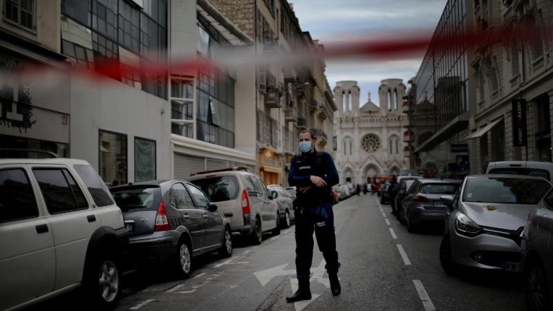 A French policeman stands guard near the scene of the knife attack at the Notre Dame church in Nice, France, on Oct. 29, 2020. (Daniel Cole / AP)