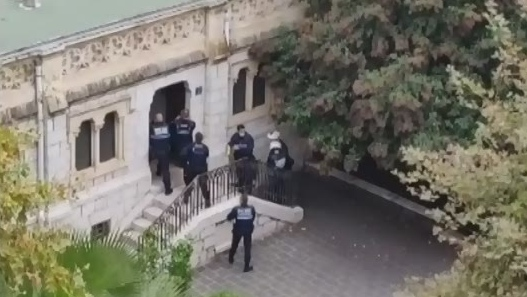 Warning: Gunshots heard as police raid basilica