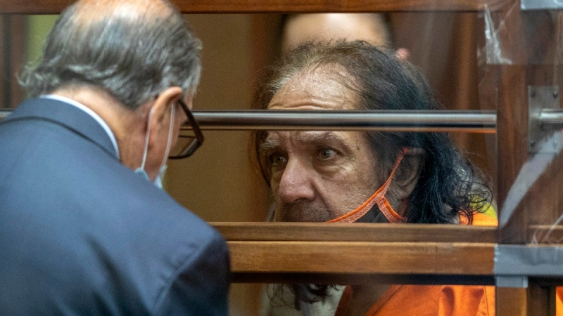 Ron Jeremy talks with his attorney Stuart Goldfarb at Clara Shortridge Foltz Criminal Justice Center in L.A., on June 26, 2020. (David McNew / Pool Photo via AP)
