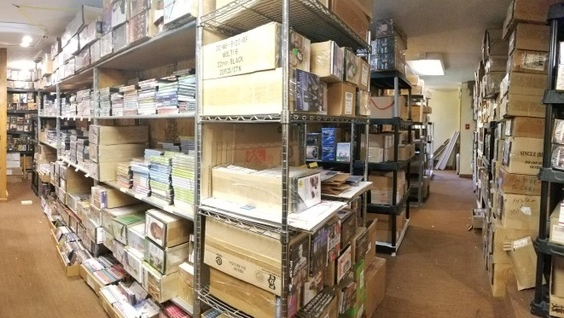 The home is filled with boxes and shelves filled with merchandise. (Keller Williams Realty)