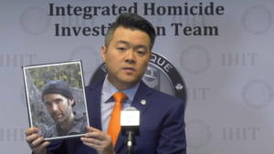 IHIT's Sgt. Frank Jang holds up a photo of Davis Wolfgang Hawke on Oct. 29, 2020, who was identified as the victim of a 2017 homicide near Squamish.