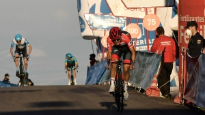 Ineos's Richard Carapaz, red shirt leader of La Vuelta, before crossing the finish line on second position behind Jumbo's Primoz Roglic at the end of the eight stage of La Vuelta between Logrono and Alto de Moncalvillo, in Logrono, northern Spain, on Oct. 28, 2020. (Alvaro Barrientos / AP)