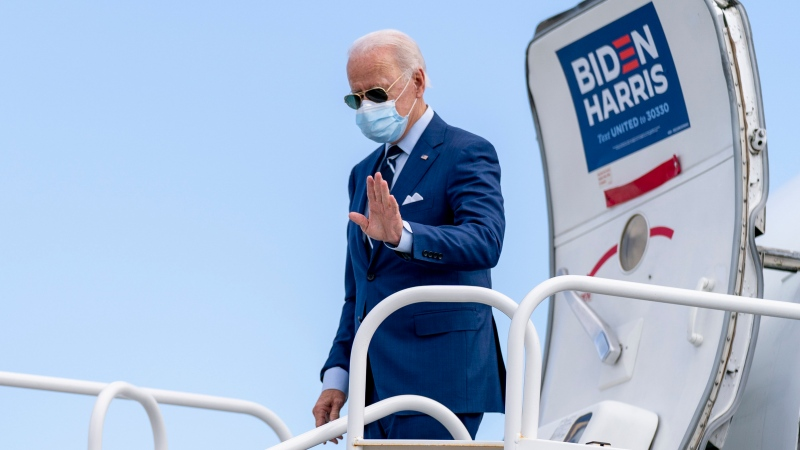Democratic presidential candidate former Vice President Joe Biden arrives at Fort Lauderdale-Hollywood International Airport in Fort Lauderdale, Fla., Thursday, Oct. 29, 2020, to attend a drive-in rally at Broward College in Coconut Creek, Fla. (AP Photo/Andrew Harnik)