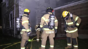 Training crews practice at a live fire at a vacant home in St. Marys