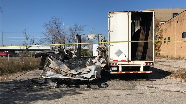 A burned out trailer in a parking lot