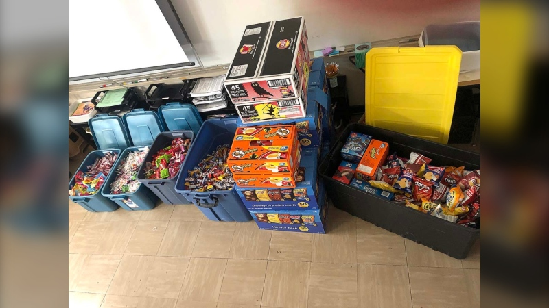 The students collected more than 9,000 pieces of candy, 650 bags of chips, and 550 other treats, such as Rice Krispies Squares and Wagon Wheels, from parents and school staff. (Source: Winnipeg School Division)