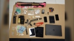 Items seized by Burnaby RCMP after arresting a man driving an alleged stolen car - Burnaby RCMP
