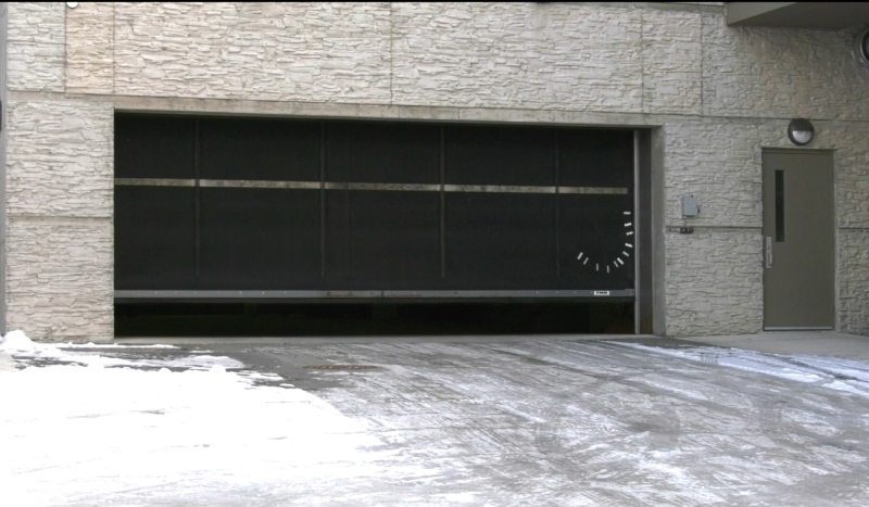 Timmins Police officials are investigating a case of vandalism at Autumnwood's St. Mary's Gardens. The door to the underground parking garage was cut earlier this week and vehicle windows were broken. (Lydia Chubak/CTV News)