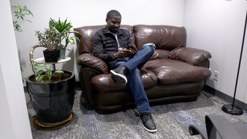 Henry Nwosu uses an app developed by Momentum and QUBER to incentivize saving. He says it helps him save for a rainy day, which could help in case he should lose his employment in the aviation industry.