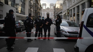 Police patrol on a street outside the Notre Dame church in Nice, southern France, after a knife attack took place on Thursday, Oct. 29, 2020. An attacker armed with a knife killed at least three people at a church in the Mediterranean city of Nice, prompting the prime minister to announce that France was raising its security alert status to the highest level. (AP / Daniel Cole)