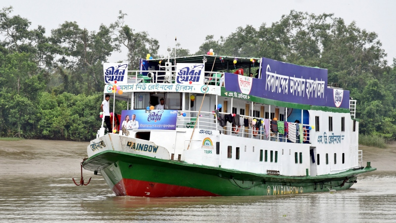 In this photo provided by Bidyanondo Foundation, floating hospital called 'Jibon Kheya', meaning lifeboat, arrives at Banishanta near Mongla seaport in southwestern region of Bangladesh, Sept. 1, 2020. (Bidyanondo Foundation via AP)