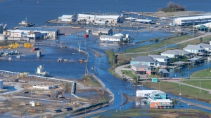 Floodwaters cover land and roads in Grand Isle, La., after Hurricane Zeta, Thursday Oct. 29, 2020. (Bill Feig/The Advocate via AP, Pool)