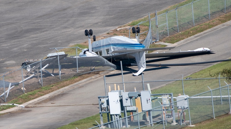 A flipped airplane at Lakefront Airport due to Hurricane Zeta damage is viewed Thursday, Oct. 29, 2020, in New Orleans, La., as part of Gov. John Bel Edwards flyover of stricken areas in the southeastern part of the state. (Bill Feig/The Advocate via AP)