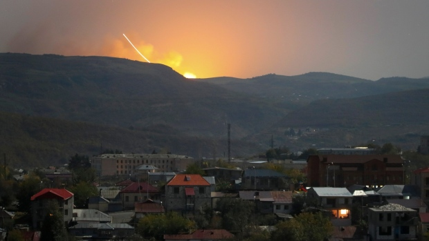 Explosions are seen behind the mountains during a military conflict outside Stepanakert, the separatist region of Nagorno-Karabakh, on Oct. 30, 2020. (AP)