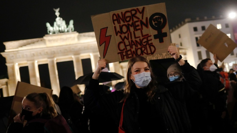A woman from Poland shows a poster as she attends a protest against recent tightening of Poland's restrictive abortion law, in front of the Brandenburg Gate in Berlin, Germany, on Oct. 29, 2020. (Markus Schreiber / AP)