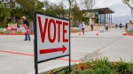 A sign directs people to an early voting poll at the Collin College campus in Wylie, Texas, on Oct. 29, 2020. (Juan Figueroa / The Dallas Morning News via AP)