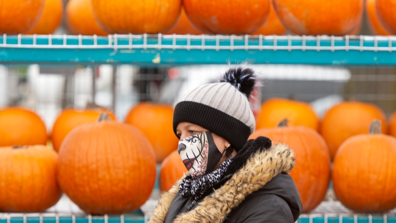 A pumpkin vendor waits for customers at a market, Wednesday, October 28, 2020 in Montreal.THE CANADIAN PRESS/Ryan Remiorz