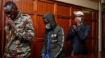 Hussein Hassan Mustafah, centre, and Mohamed Ahmed Abdi, right, who were both found guilty of supporting the gunmen involved in the Westgate Mall attack in Sept. 2013, leave after the verdict is delivered in their trial at Milimani court in the capital Nairobi, Kenya, on Oct. 7, 2020. (Brian Inganga / AP)