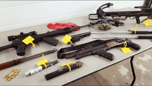Weapons seized during the search of a Coaldale, Alta. home on Oct. 15. Ethan Wiebe, 20, faces charges in connection with the investigation (ALERT)