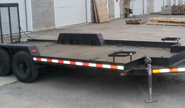 The black 1990 Centennial JCTR dual axle 20' long flatbed trailer was stolen sometime between Aug. 28 and Oct. 26. (Supplied)