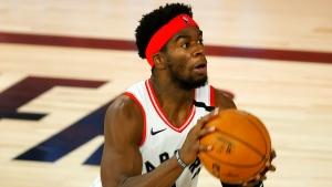 Toronto Raptors' Terence Davis (0) handles the ball during the third quarter against the Denver Nuggets in an NBA basketball game Friday, Aug. 14, 2020, in Lake Buena Vista, Fla. (Mike Ehrmann/Pool Photo via AP)
