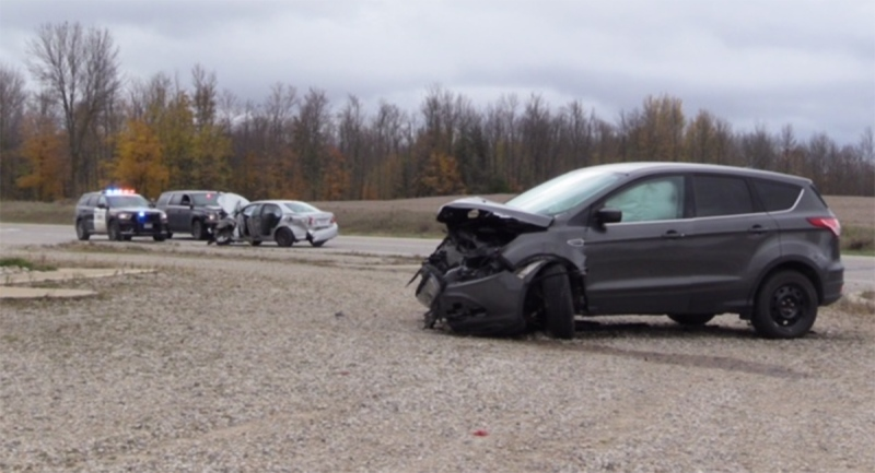 OPP respond to the scene of a two-vehicle crash near Bluevale, Ont. on Friday, Oct. 30, 2020. (Scott Miller / CTV News)