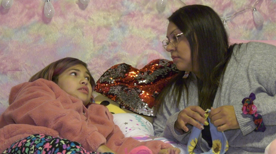 Arizona Burns, left, with her mother, Sharice Cardinal. Oct. 30, 2020.