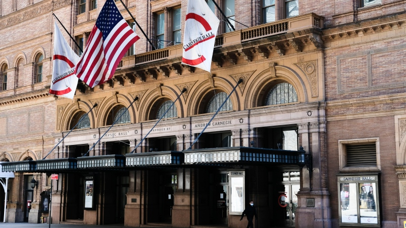 This May 12, 2020 file photo shows Carnegie Hall in New York. Carnegie Hall has extended its closure due to the novel coranavirus pandemic through April 5, 2021. (Photo by Evan Agostini/Invision/AP, File)