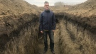 Clavet High School history teacher Jonathan Nickel had his Grade 11 students dig a nine-metre trench in the mud. (Chad Leroux/CTV Saskatoon)