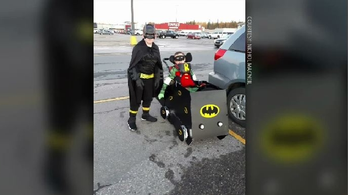 Devon MacNeil shows off the homemade Batman costume his mom Nichol made. (COURTESY NICHOL MACNEIL)