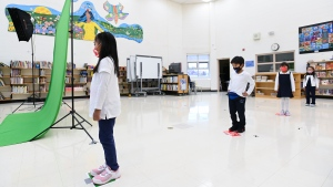 Children wait using physical distancing while getting their picture taken at picture day at St. Barnabas Catholic School during the COVID-19 pandemic in Scarborough, Ont., on Tuesday, October 27, 2020. THE CANADIAN PRESS/Nathan Denette