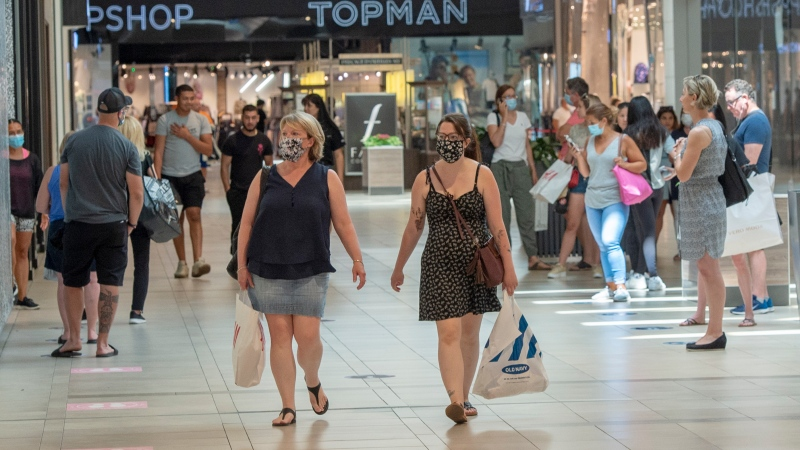 Shoppers walk through Carrefour Laval shopping center as malls across Quebec reopened amid the COVID-19 pandemic, Friday, June 19, 2020 in Laval, Que.THE CANADIAN PRESS/Ryan Remiorz