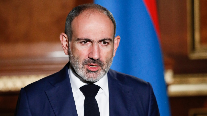 In this photo provided by the Armenian Prime Minister Press Service via PAN Photo, Armenian Prime Minister Nikol Pashinyan addresses the nation in Yerevan, Armenia, Tuesday, Oct. 27, 2020. (Tigran Mehrabyan, Armenian Prime Minister Press Service/PAN Photo via AP)