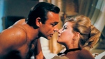 Daniela Bianchi kisses Sean Connery, left, as James Bond in a scene from the 1963 film, 'From Russia With Love.' (United Artists and Danja)