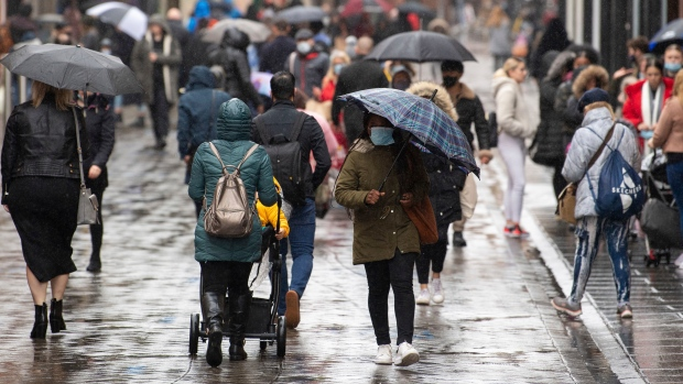 Many people wearing face masks as they move along a main shopping street in Nottingham, England, Tuesday Oct. 27, 2020. (Joe Giddens/PA via AP)