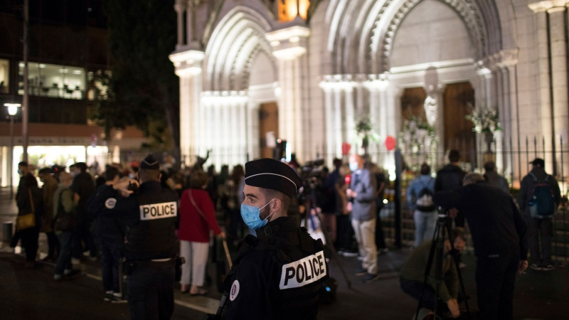 A policeman stands guard in front of the Notre Dame church in Nice, France, Friday, Oct. 30, 2020. (AP Photo/Daniel Cole)