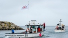 Indigenous lobster boats head from the harbour in Saulnierville, N.S. on Wednesday, Oct. 21, 2020. Tensions remain high over an Indigenous-led lobster fishery that has been the source of conflict with non-Indigenous fishermen. THE CANADIAN PRESS /Andrew Vaughan