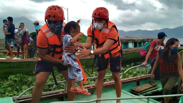 Coastguard workers evacuate residents from the coastal villages of Buhi town, Camarines Sur province, south of Manila. (AFP)