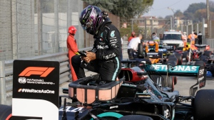 Mercedes driver Lewis Hamilton of Britain steps out of his car after clocking the second fastest time during qualification ahead of Sunday's Emilia Romagna Formula One Grand Prix, at the Enzo and Dino Ferrari racetrack, in Imola, Italy, Saturday, Oct. 31, 2020. (AP Photo/Luca Bruno, Pool)